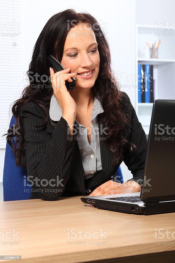 Beautiful business woman using telephone at work royalty-free stock photo