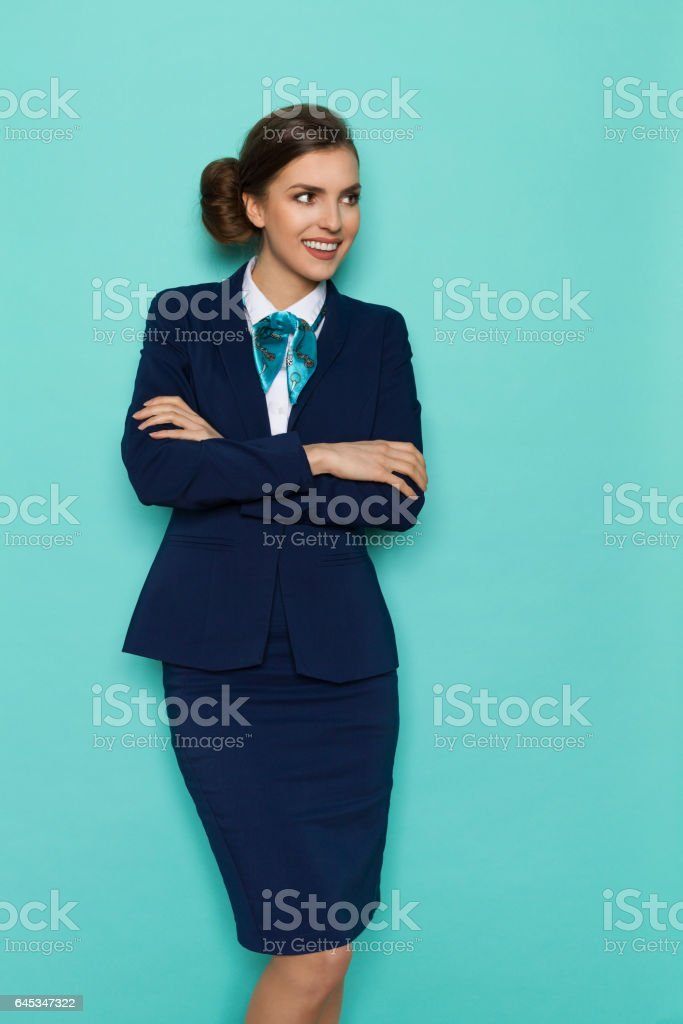 Beautiful Business Woman With Arms Crossed Looking Away stock photo