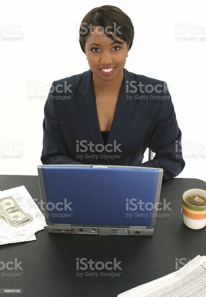 Beautiful Business Woman with Bills and Cup of Tea royalty-free stock photo