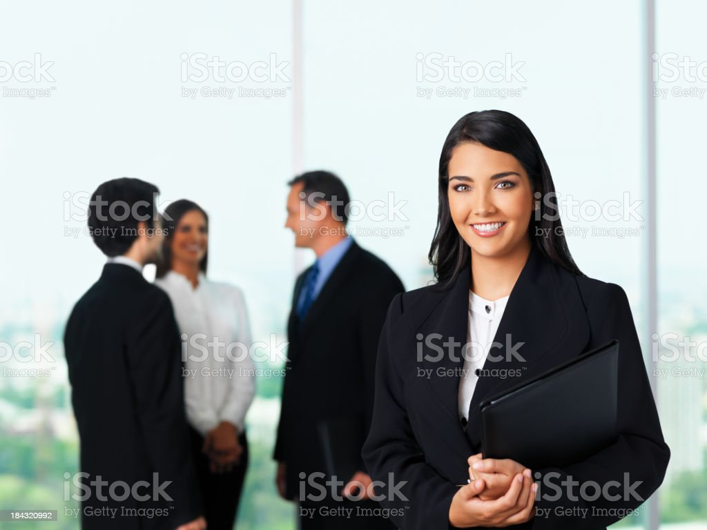 Beautiful business woman with her team royalty-free stock photo