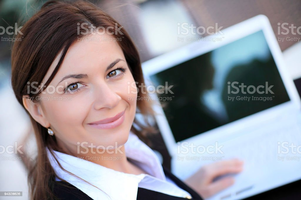 Beautiful business woman with laptop. royalty-free stock photo
