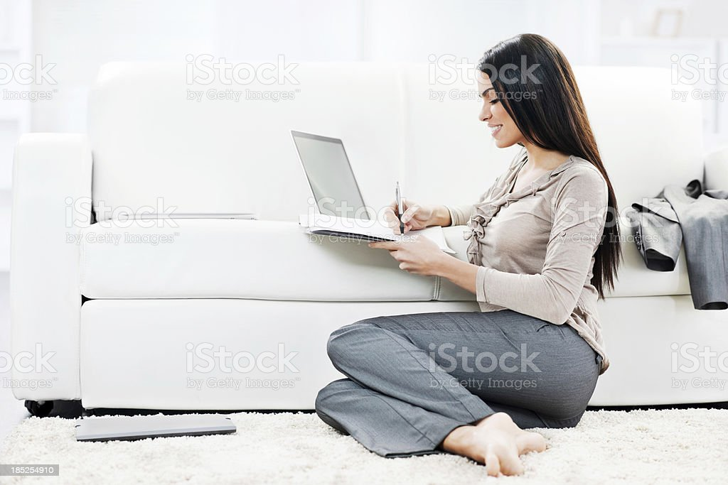Beautiful business woman working at home. royalty-free stock photo
