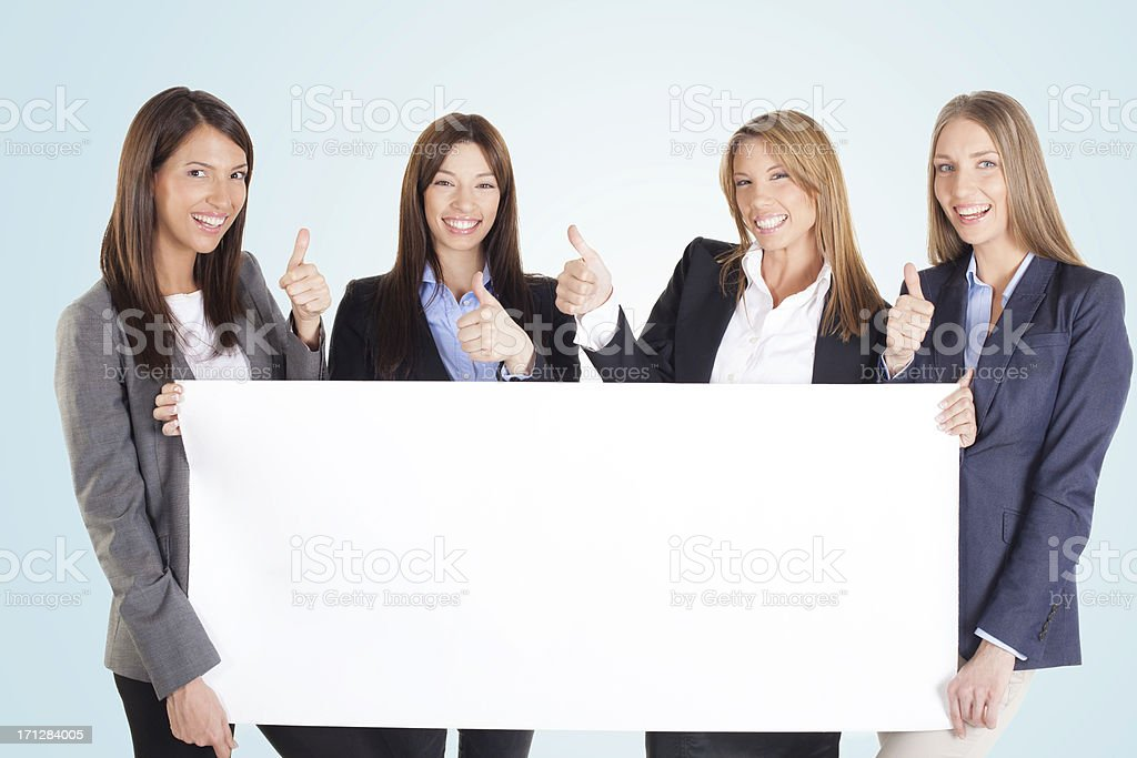 Beautiful business Women holding a blank white board royalty-free stock photo
