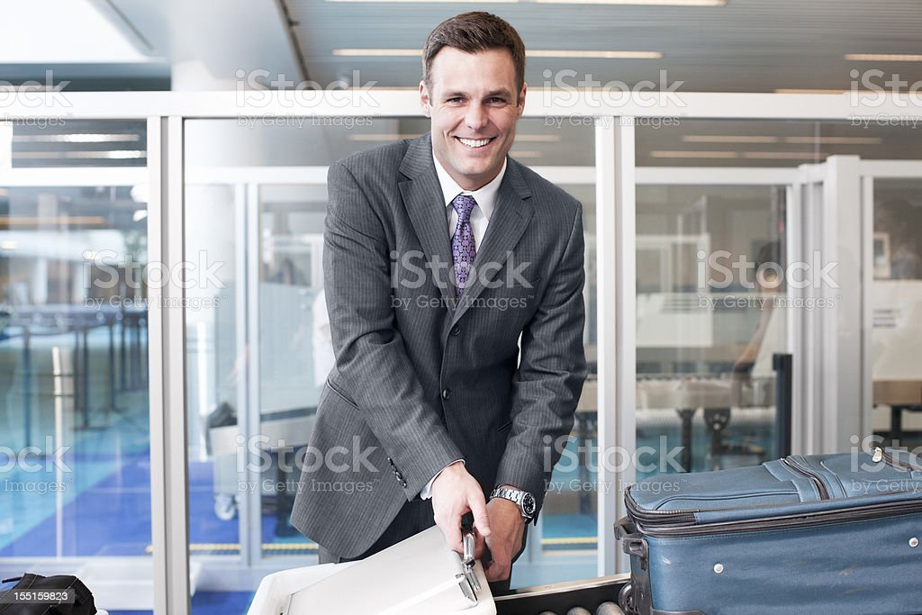 Beautiful Businessman Smiling at Airport Security, Copy Space stock photo