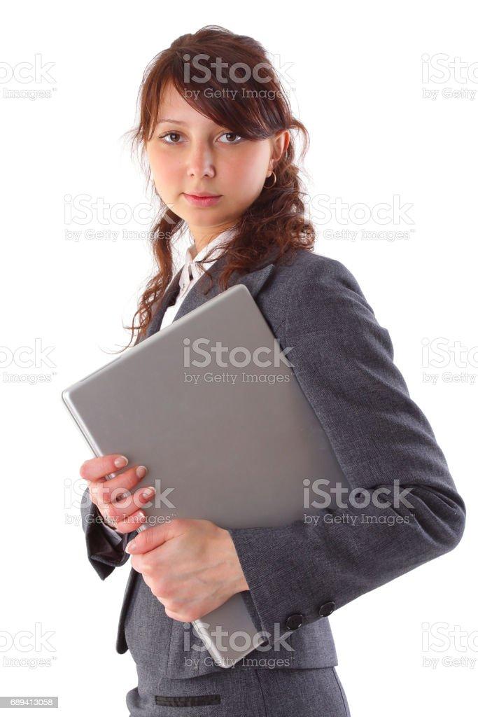 beautiful businesswoman carrying a laptop stock photo