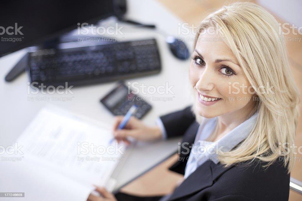 Beautiful businesswoman doing finances stock photo
