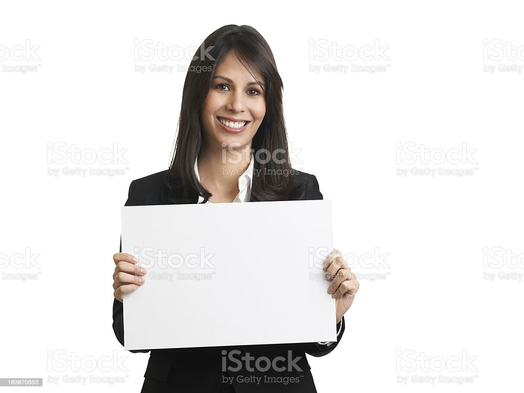 Beautiful businesswoman holding a blank sign stock photo
