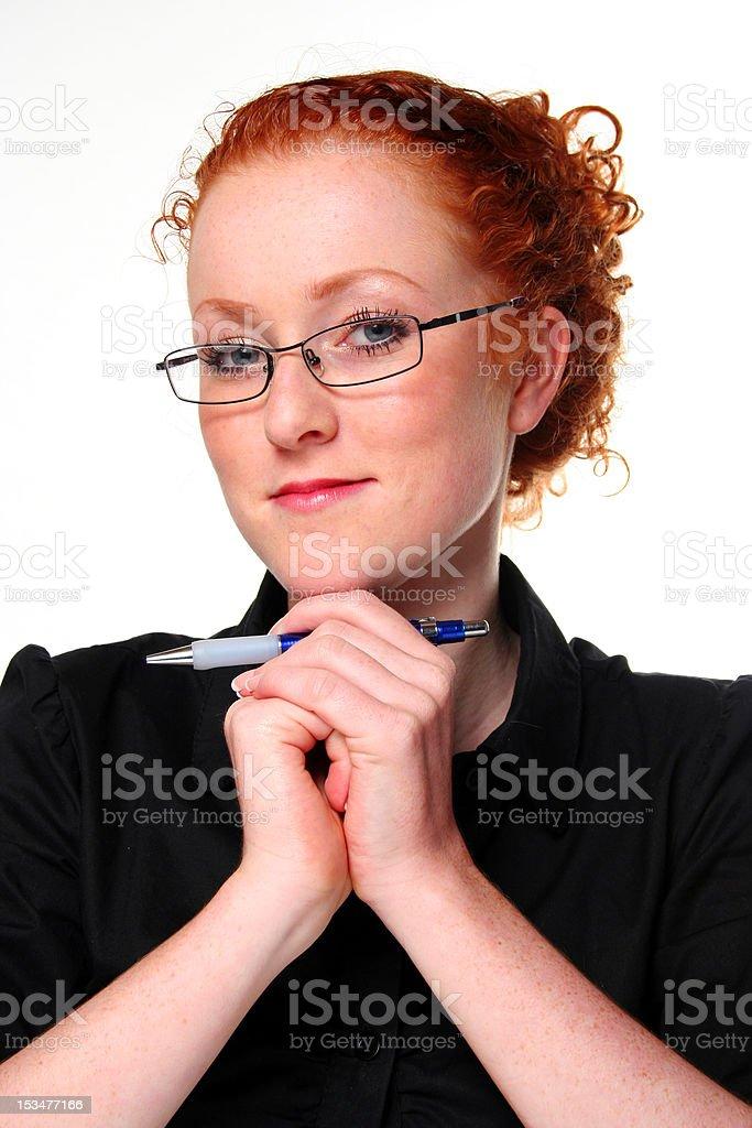 beautiful businesswoman holding a pen stock photo
