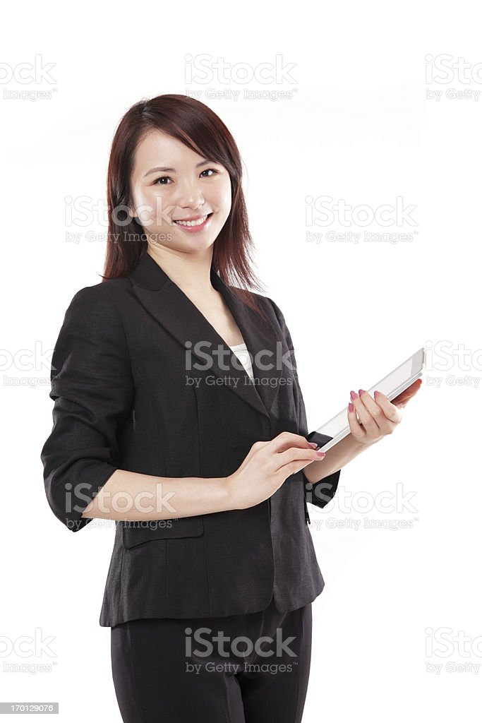 Beautiful Businesswoman Holding a Tablet Smiling on White Background royalty-free stock photo