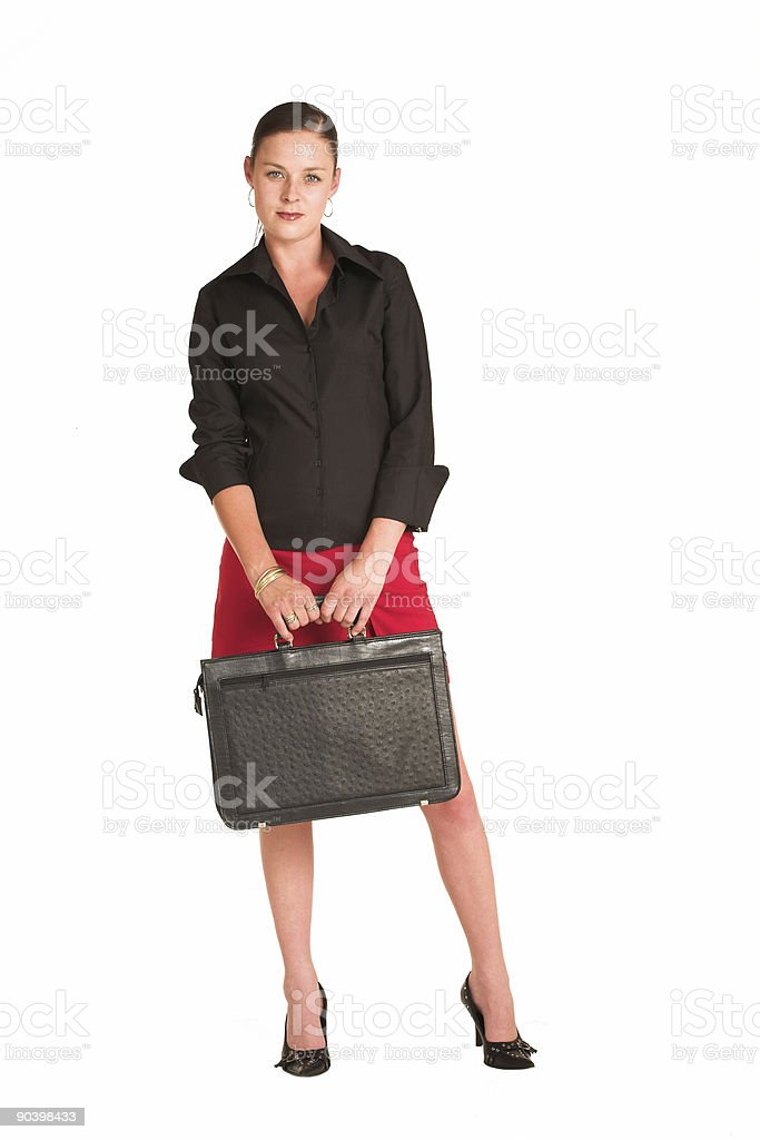 Beautiful businesswoman in a miniskirt with leather briefcase royalty-free stock photo