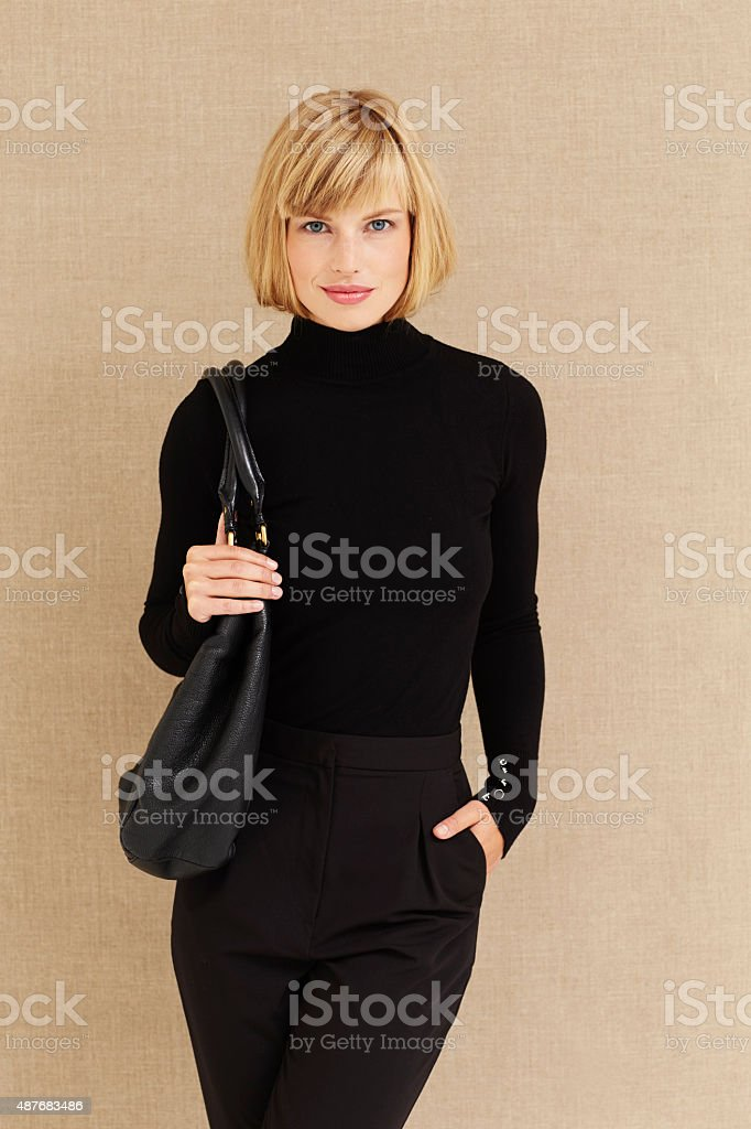 Beautiful businesswoman in black stock photo