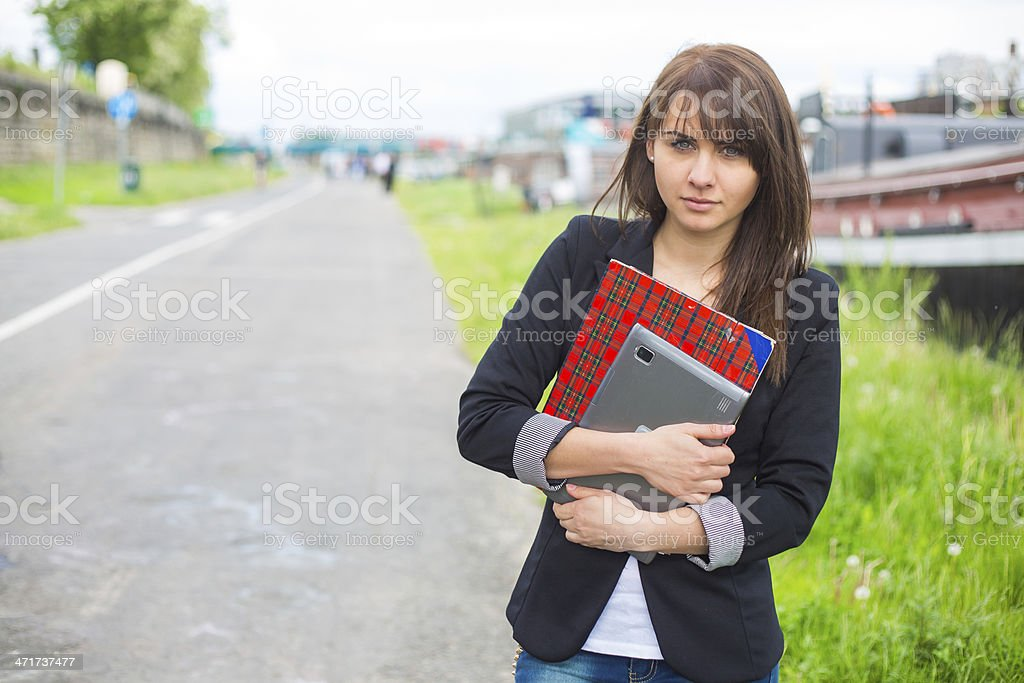 Beautiful businesswoman on break in park. royalty-free stock photo