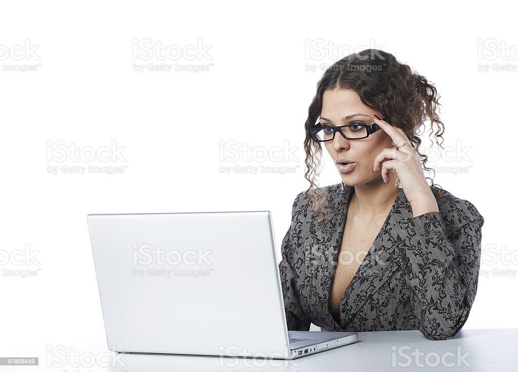 Beautiful businesswoman reading news at laptop royalty-free stock photo