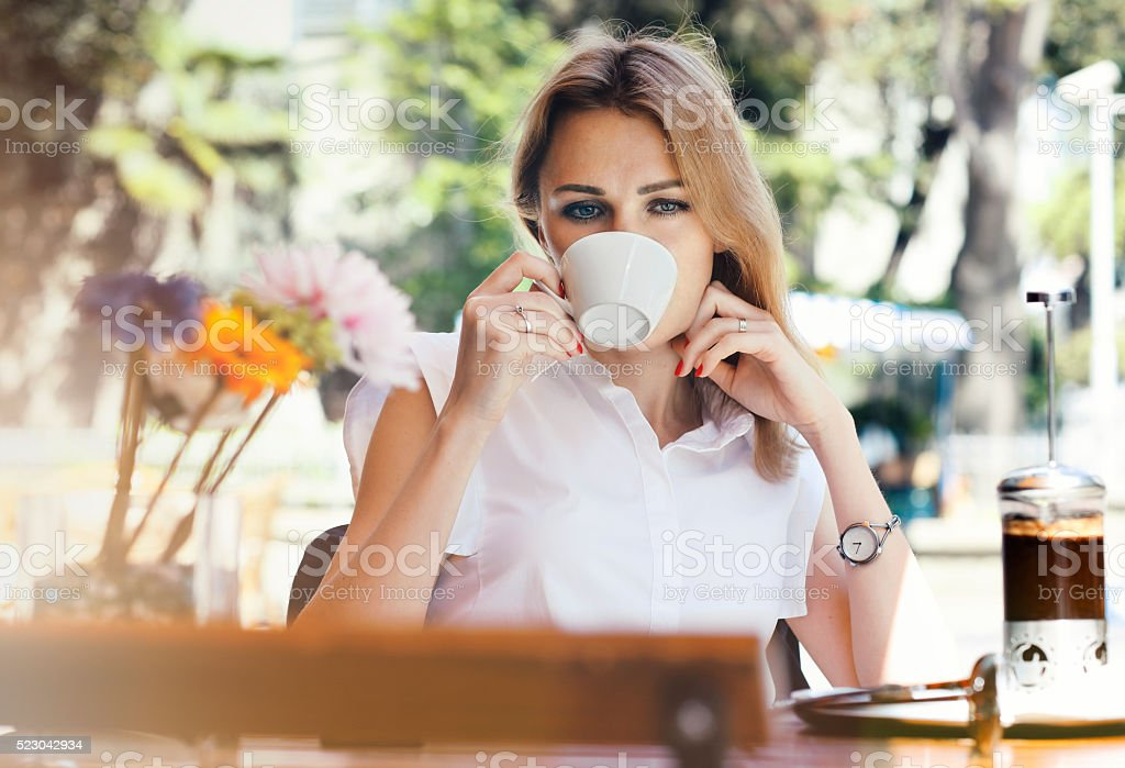 Beautiful businesswoman resting in cafe stock photo