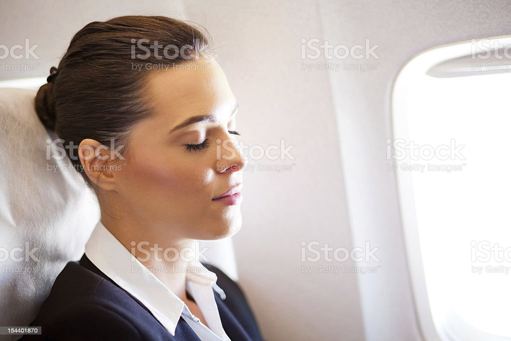 beautiful businesswoman resting on airplane royalty-free stock photo