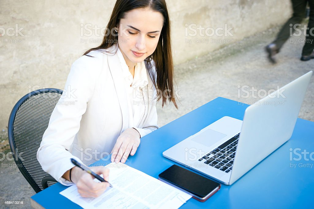 Beautiful Businesswoman Signing Contract stock photo