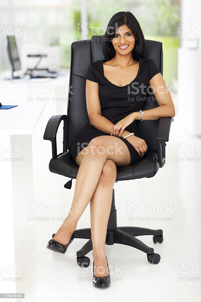 beautiful businesswoman sitting in modern office royalty-free stock photo