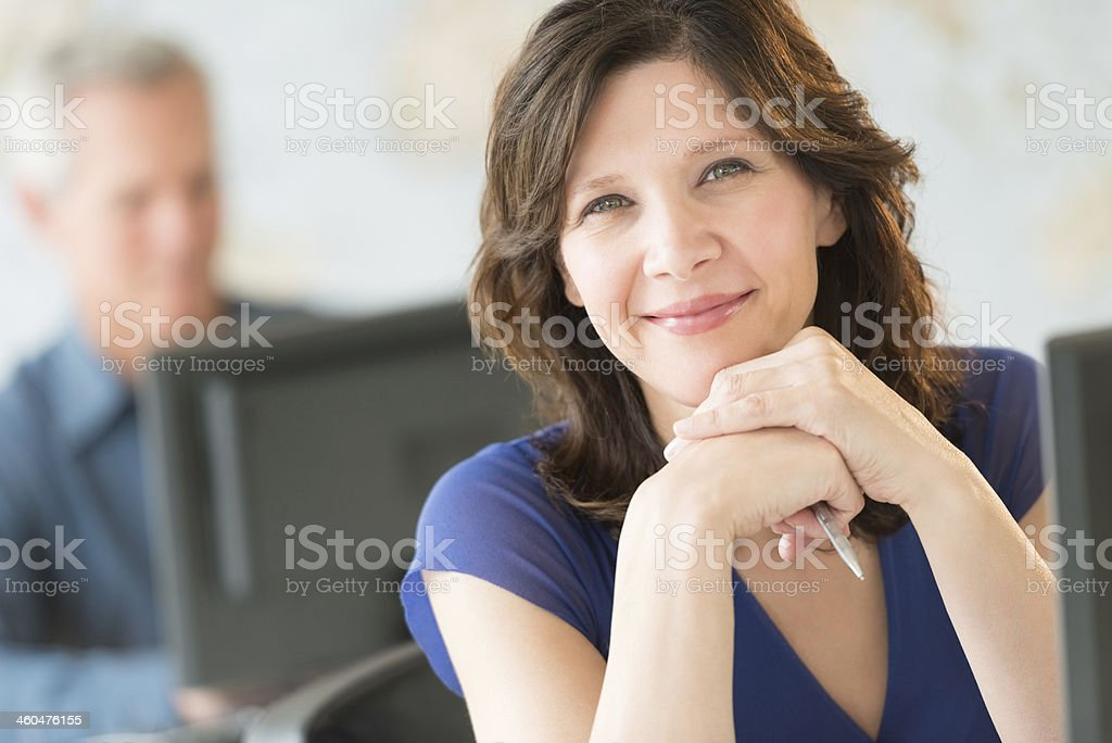 Beautiful Businesswoman Smiling In Office stock photo