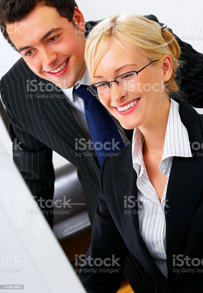 Beautiful businesswoman smiling with a businessman royalty-free stock photo