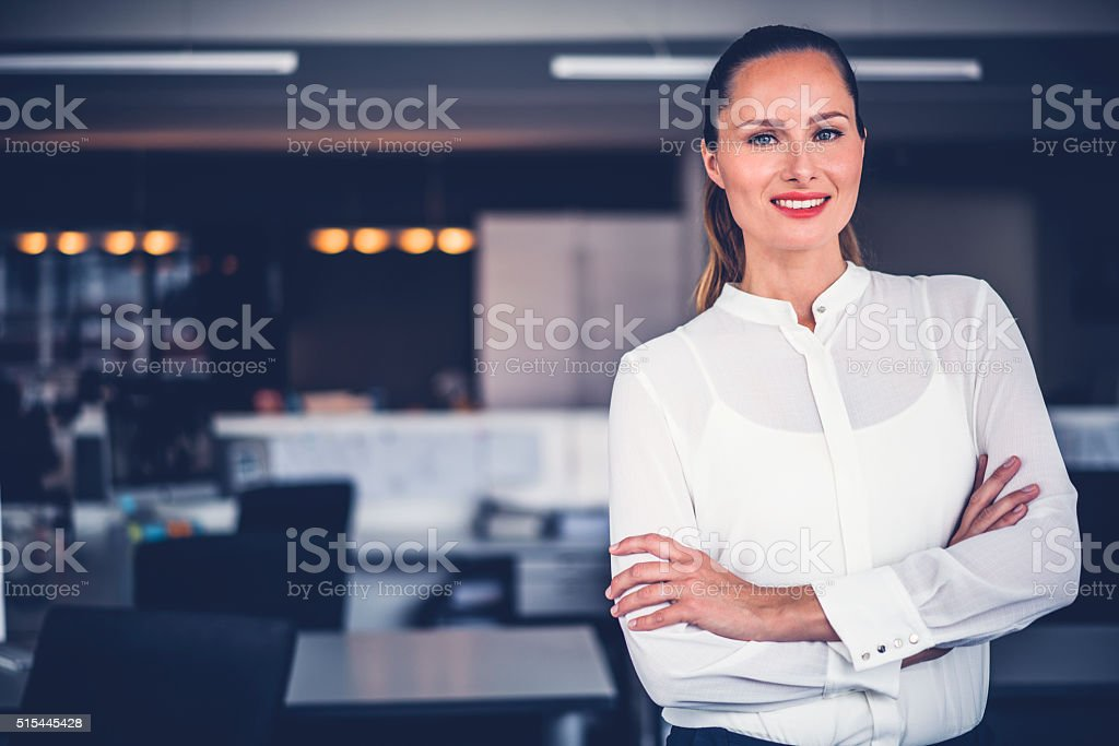 Beautiful businesswoman standing arms crossed stock photo