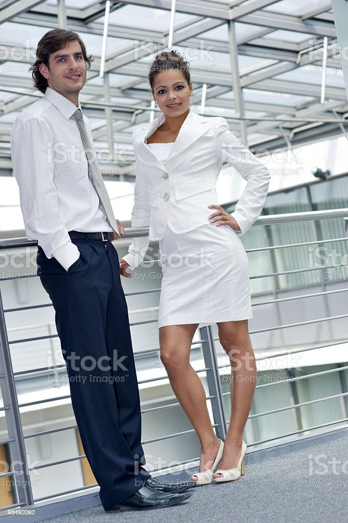 Beautiful businesswoman standing with her colleagues stock photo