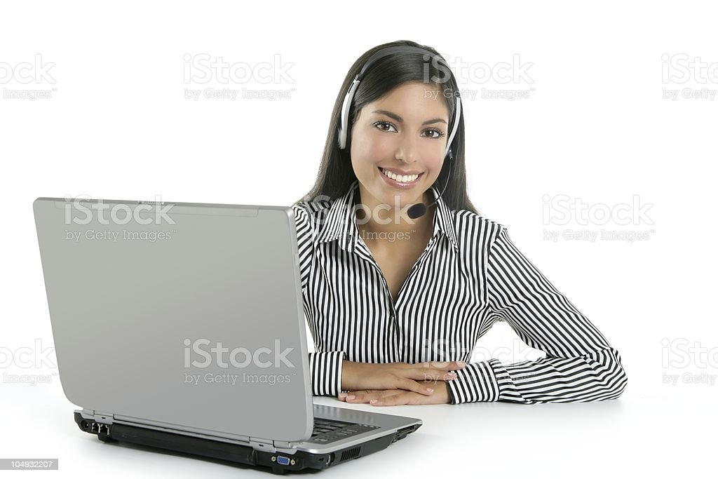 Beautiful businesswoman talking with headset royalty-free stock photo