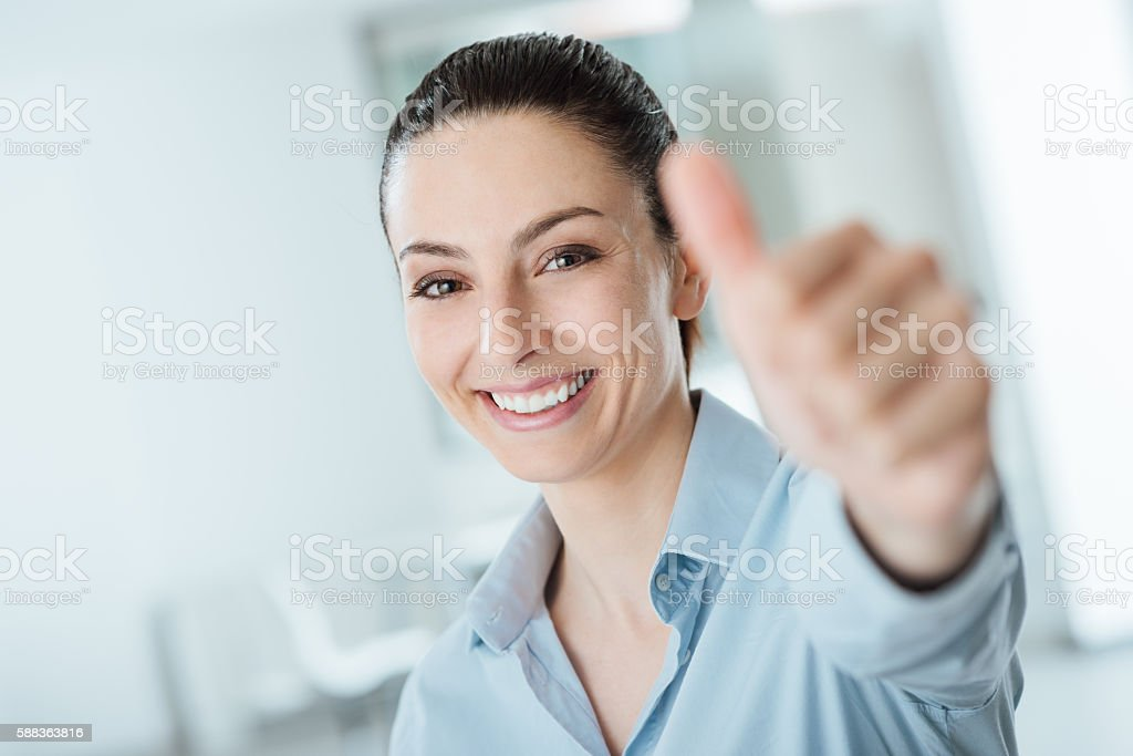 Beautiful businesswoman thumbs up stock photo