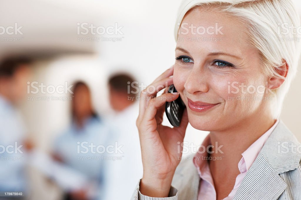Beautiful businesswoman using cellphone at office stock photo