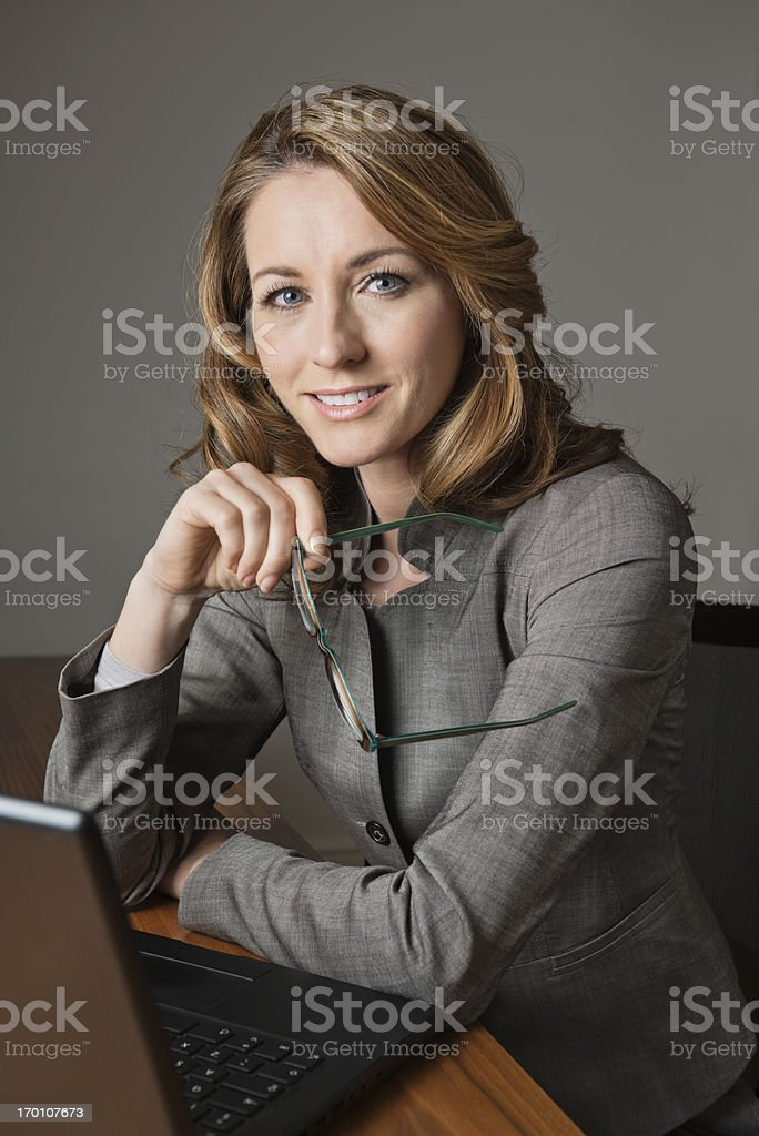 Beautiful Businesswoman With Glasses And Laptop royalty-free stock photo