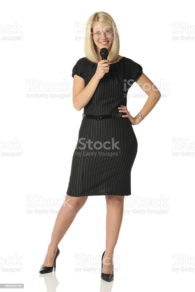Beautiful businesswoman with microphone royalty-free stock photo