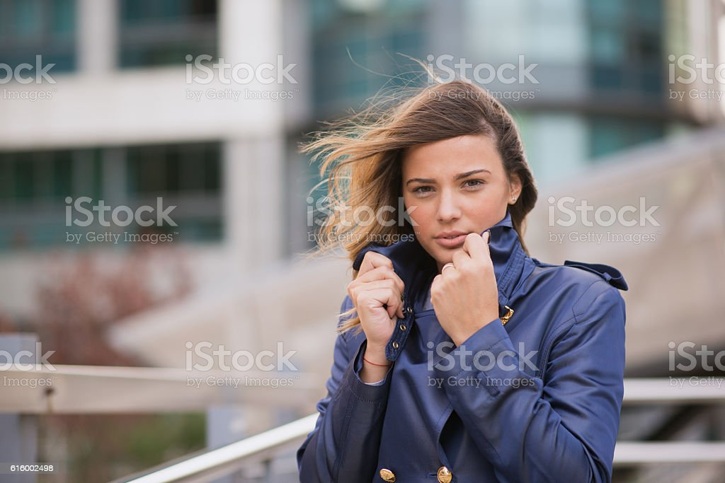 Beautiful businesswoman with wind in her hair -  fluttering stock photo
