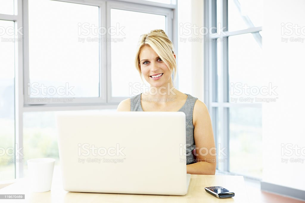 beautiful businesswoman working on laptop royalty-free stock photo