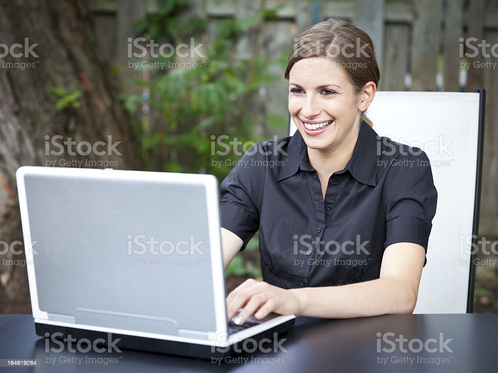 Beautiful  Businesswoman Working Outside On her Laptop royalty-free stock photo
