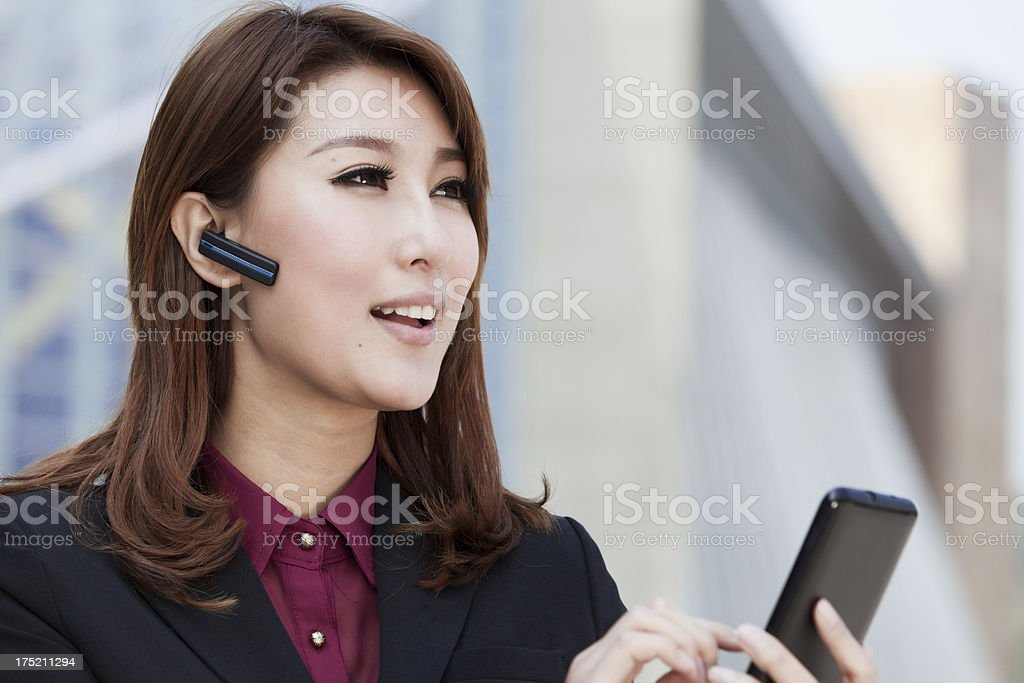 Beautiful businesswomen making phone call stock photo