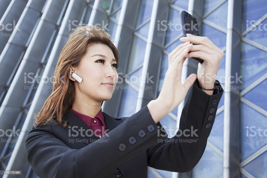 Beautiful businesswomen making video call with smart phone royalty-free stock photo