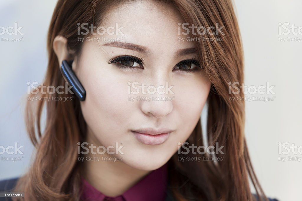 Beautiful businesswomen with blutooth earphone royalty-free stock photo