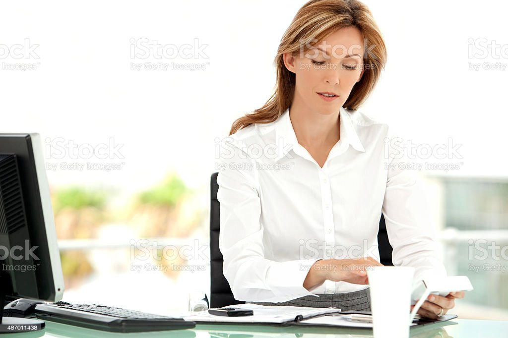 Beautiful busy business manager stock photo