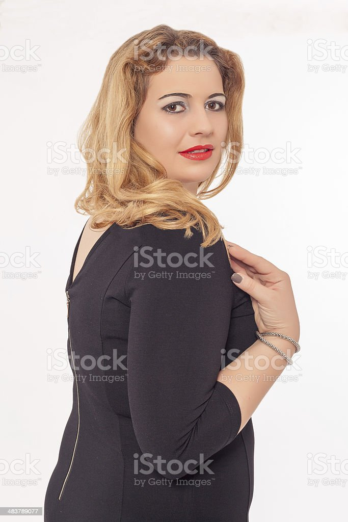 Beautiful buxom woman in a black dress stock photo