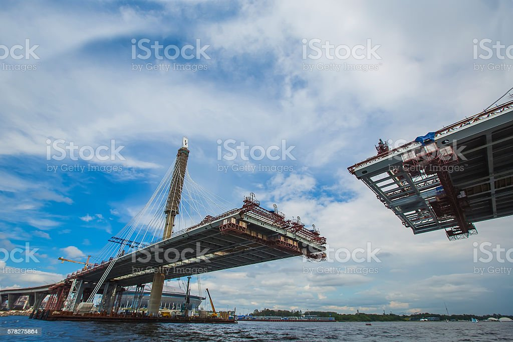 beautiful cable-stayed bridge in the construction process. summe stock photo