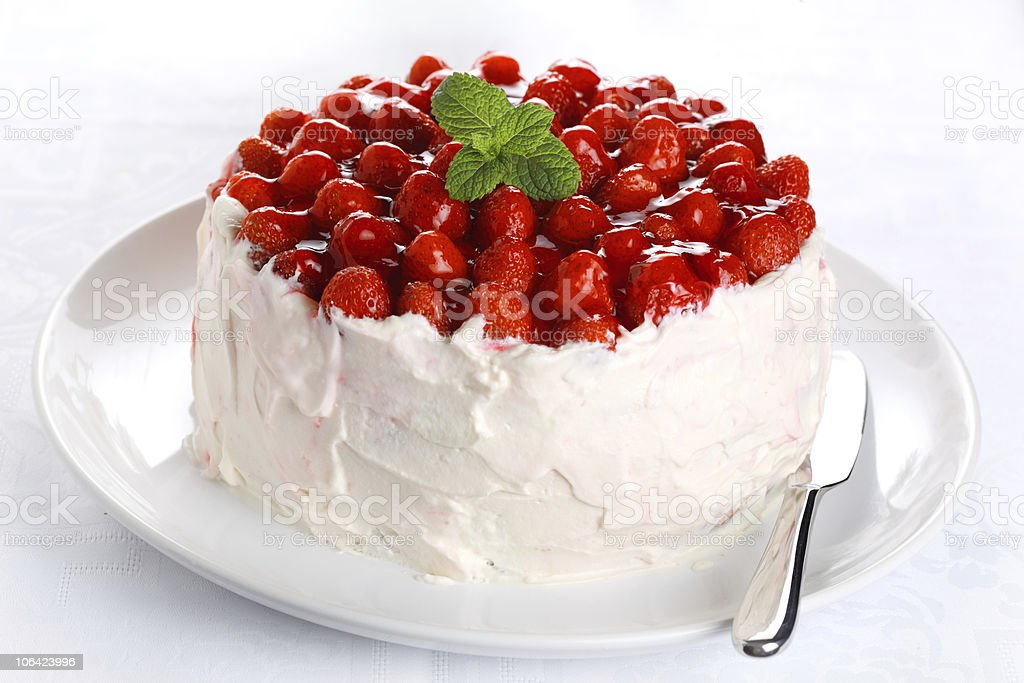 beautiful cake with strawberries and cream stock photo