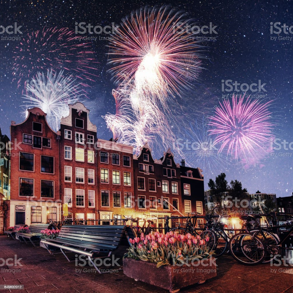 Beautiful calm night view of Amsterdam city. Colorful fireworks stock photo