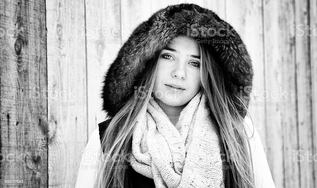 Beautiful Canadian teenager portrait with fur black and white stock photo