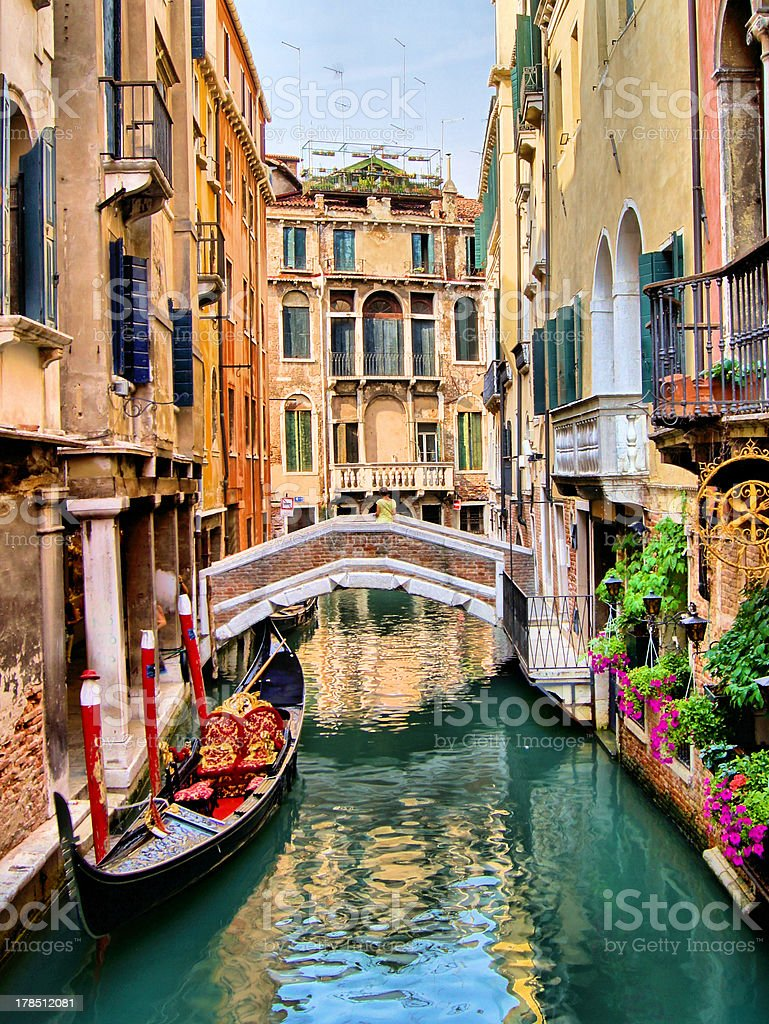 Beautiful canal scene with gondola, Venice, Italy stock photo