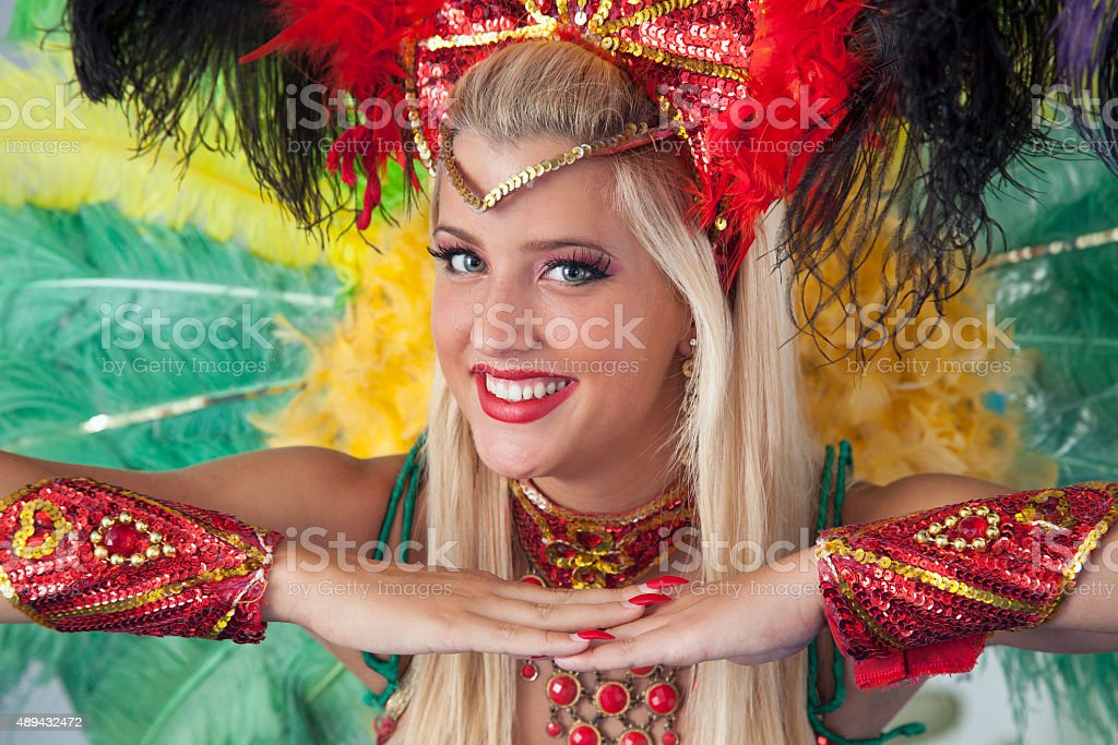Beautiful carnival dancer smiling and looking at camera. stock photo