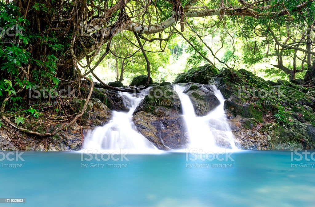 Beautiful cascade fall in tropical forest royalty-free stock photo