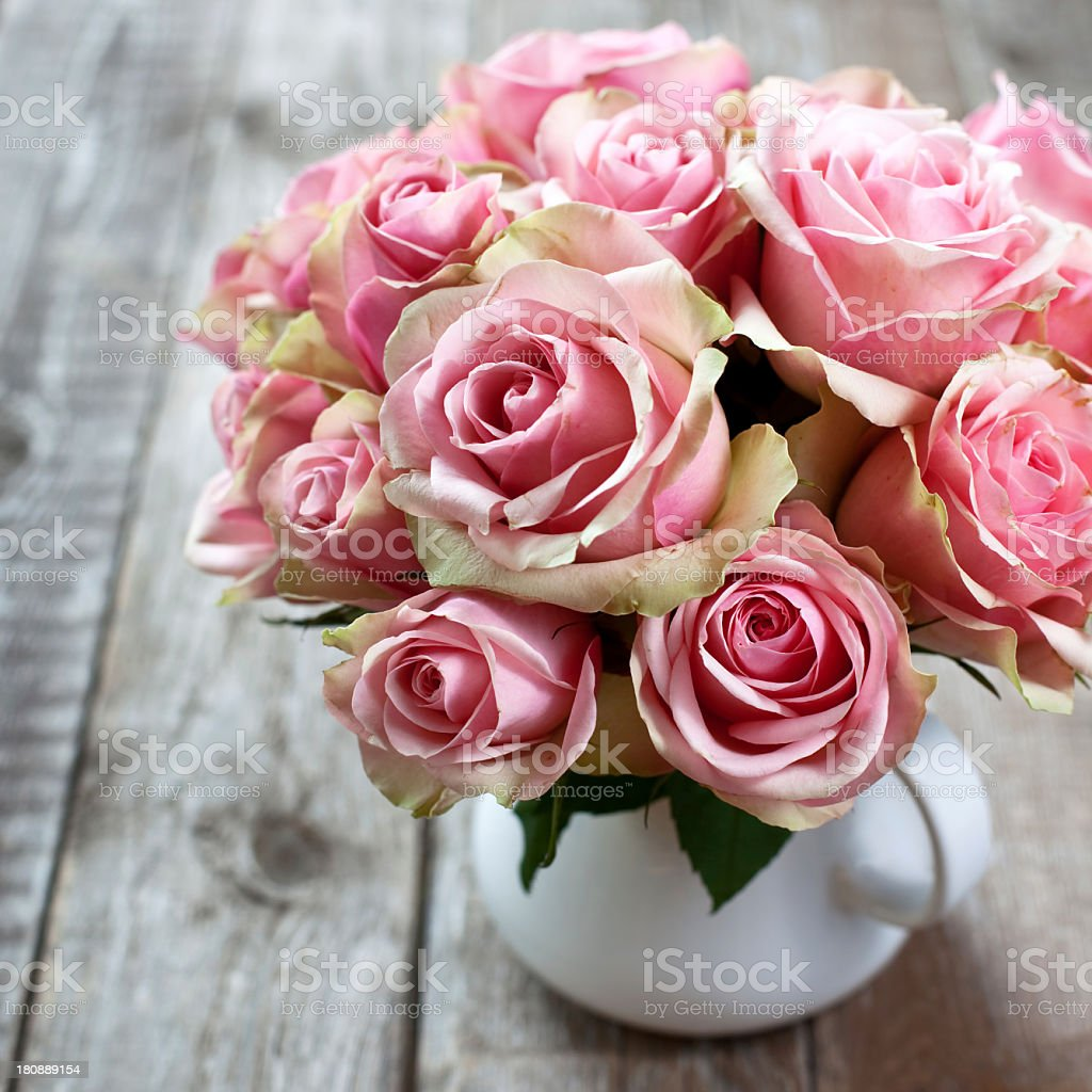 A beautiful case with a dozen pink roses stock photo