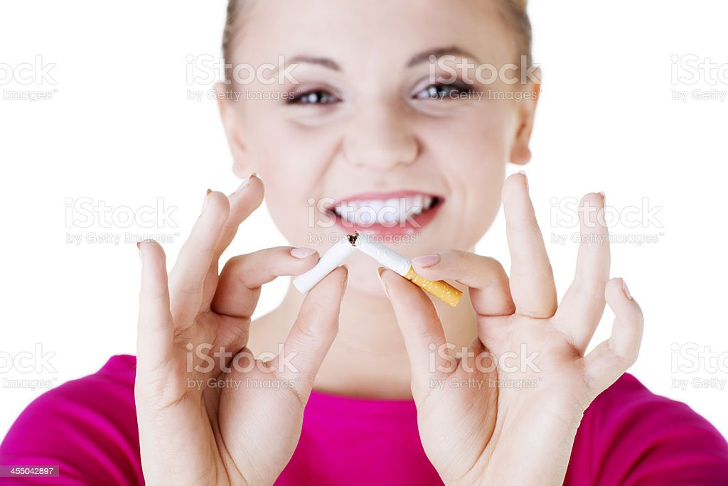 Beautiful casual girl holding broken cigarette. stock photo
