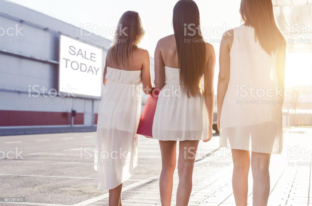 Beautiful casual girls in shopping stock photo