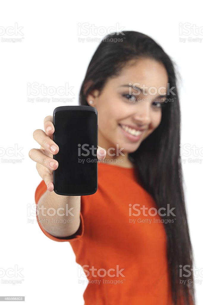 Beautiful casual muslim woman showing a blank smartphone screen stock photo