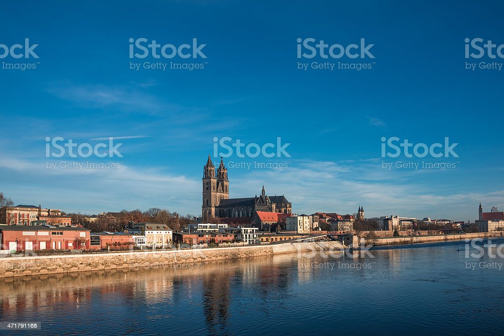 Beautiful cathedral of Magdeburg, river Elba and old town stock photo